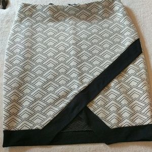 Express cream and black skirt